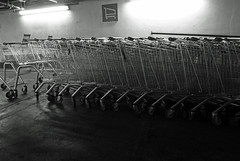 trolleys in low light (dawn.v) Tags: uk england blackandwhite monochrome shop underground store lowlight may supermarket dorset everyday carpark bournemouth shoppingcarts consumerism trolleys stacked ordinary winton trolleypark lumixtz25