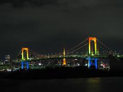 1550 Rainbow Bridge Earns its Namesake (mari-ten) Tags: bridge sea nature japan geotagged lights tokyo cityscape nightshot zoom  tokyotower  odaiba roppongihills 2009  minato kanto tokyobay rainbowbridge   eastasia      200912 20091231 mygearandme mygearandmepremium mygearandmebronze mygearandmesilver mygearandmegold geo:lat=3562767739999144 geo:lon=13977133333683014