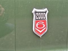 Elegant emblem (ClassicsOnTheStreet) Tags: detail ford emblem logo 2000 schild ornament badge automatic taunus 1973 v6 tc1 chromium wapen wapenschild sigle embleem gxl naamplaatje typeplaatje merkplaatje 3888zh