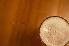 Full beer in glass on timber table top (Robert Lang Photography) Tags: light cold color colour wet beer glass horizontal brewing table drink timber top stock beverage ale dry australia nopeople full rim heavy brew lager pilsner refreshment beir