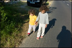 L&M in pyjamas on the road (Sapient Iguana) Tags: kids children child holdinghands photographersshadow holdhands childrenholdinghands lucianlanteri