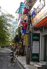 Hanoi .The Cable Guys (Marco Sarli) Tags: street climb tv candid cable pole vietnam motorcycle ladder hanoi