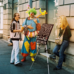 A suspicious clown (Milos Kondic) Tags: street people film look standing clown serbia electro belgrade gsn talking 35 dm yashica seller beograd suspicious klovn srbija paradies knez distrustful mihajlova sumnjicavi