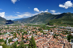 Riva del Garda and the Dolomites (charlottehbest) Tags: blue sky italy mountains sunshine buildings town garda europe italia rooftops riva sunny roofs dolomites lakegarda lagodigarda rivedelgarda