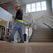Construction worker walks through the foyer of the Poole Clubhouse.