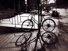 In Tandem (Feldore) Tags: street canada lines bike bicycle sepia contrast standing mono high shadows montreal olympus strong railings mchugh e510 feldore