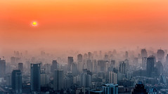 City in the mist (Santo(Thanks for 1.3 Million++views!!)) Tags: city morning winter sun mist building fog skyline architecture sunrise thailand colorful asia bangkok aerial drama