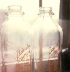 milk bottles (lawatt) Tags: film glass milk bottles instant slr680 peninsulacreamery theimpossibleproject color600
