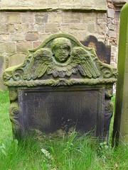 Angel side (Nekoglyph) Tags: trees green graveyard stone angel carved wings faces yorkshire text feathers historic cherub gravestone oldchurch holycross whorlton henrytod
