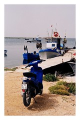 Scooter (joaofreitas) Tags: blue sea italy film tourism analog boats outdoors seaside holidays scooter olympus sicily marsala