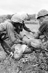 A medic gives blood transfusion to a 101st airborne soldier in futile effort to save his life at An Ninh, South Vietnam, September 18, 1965. Wounded when helicopters bringing in his unit were hit by heavy fire and pinned down for 24 hours, he died three h (Histolines) Tags: life history by soldier fire for three hit blood being south wounded down save an retro september vietnam when his timeline were after hours effort 24 bringing helicopters he 18 heavy medic airborne gives died 1965 unit 101st pinned futile ninh transfusion vinatage a historyporn histolines 1977x3048 httpifttt1tzgkfl