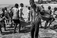 Are you looking at me... or at the shark behind...? (Srgio Miranda) Tags: africa street people urban blackandwhite bw beach photography photo streetphotography fujifilm mozambique moz pemba travelphotography x100 bwstreet fujix sergiomiranda x100t fujix100t