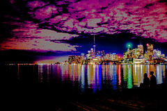 Night Light @ Jennifer Kateryna Koval's'kyj Park (Lightroom Fun) (A Great Capture) Tags: downtown bright digital colourful colorful ontario canada harbour night people two looking serene light toronto reflection canon eos agreatcapture agc wwwagreatcapturecom adjm on canadian photographer ash2276 ald mobilejay jamesmitchell spring springtime 2016 city lights urban dark nighttime blue green red pink purple yellow grey gray cntower cn tower thesix streetshot streetphotgraphy the port lands jennifer kateryna kovalskyj park polson st clouds silhouette lakeontario skyline buildings shore ig specialeffects