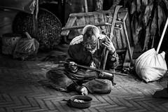 Street Musician in Luang Prabang (Mild Delirium) Tags: poverty city winter people blackandwhite bw evening la southeastasia gente streetphotography ciudad invierno laos lao luangprabang pobreza     louangphabang blancoandnegro    sudestedeasia  xf56mmf12r xf56mm fujinonxf56mmf12r fujifilmxt10