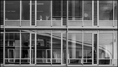 Office Talks (frischauge) Tags: street city urban bw woman white reflection building geometric window monochrome lines mobile architecture town office back pattern fuji open phone geometry candid curves x line reception architektur sw fujifilm 1855mm 1855 frau curve talking shape parallel rectangle fujinon gebäude geometrie xf geometrisch xe1 xtrans xmount wsstreet xf1855 wsarchitecture