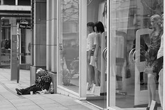 DSC03728 BW RS (bevmanders) Tags: street blackandwhite bw woman reflections germany mannequins stuttgart candid homeless streetphotography sp shopwindow begging pathos bevmanders