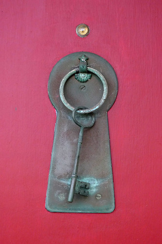 knocker on red door