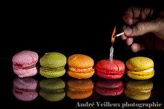 Macarons (inde07 (Andr Veilleux)) Tags: pink red food orange reflection green colors rose yellow jaune french dessert rouge fire candle desert sweet cream vert macaroon bakery pastry chandelle macarons allumette