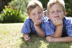 42-15117682 (anchor1203) Tags: 2 portrait people cute boys childhood smiling youth yard children outdoors togetherness twins backyard eyecontact friendship brothers lawn posed siblings males whites posture copyspace domesticscenes everydayscenes humanrelationships reclining handsonhead lyingdown headandshoulders facialexpression similarity identicaltwins headandshouldersportrait 56years handsonface headinhands