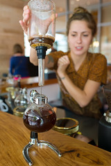 Siphon - Finished Brewing (-Dons) Tags: woman usa glass coffee austin texas unitedstates tx barista coffeehouses siphon houndstoothcoffee houndstoothfrost siphoncoffeepot