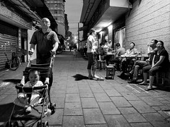 After dinner (Der Vorleser) Tags: street blackandwhite bw monochrome night asia candid 28mm streetphotography snap gr ricoh grd grd4