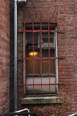Barred Window (Joel Bramley) Tags: old light brick window bars decay steel archetecture barred