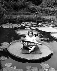 Girl sits on a lily pad in Beal Gardens, 1938 (Michigan State University Archives) Tags: lilypad msc pennant michiganstatecollege bealbotanicalgardens