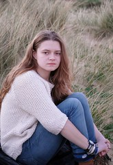 Tucked up in a Ball (Dusts Photography) Tags: green beach girl grass female sand women jeans teen heath teenager jumper tall wooly southwold woolen