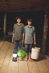 Night hunters (Adriana Gomez (Adriana Varela)) Tags: boy net childhood night outdoors bucket child brothers critter catching porch frogs lantern boyhood hunters