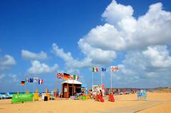 Colori al vento - Colours in the wind (Ola55) Tags: sardegna sea italy beach clouds nuvole mare wind cloudy blu windy bluesky flags cielo vento italians bandiere nuvoloso ventoso spieggia mywinners aplusphoto ola55