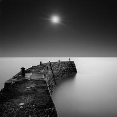 sunburst (Martin Mattocks (mjm383)) Tags: longexposure sky blackandwhite seascape water mono pier horizon sunburst cornwalllandscapes mjm383 martinmattocksphotography