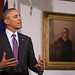 President Obama makes remarks with Thomas Sully portrait of Thomas Jefferson in the background