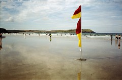 safe surf (Born in York) Tags: beach bay seaside sand cornwall surf flags homedeveloped harlyn tetenal konicapop fujicolorc200
