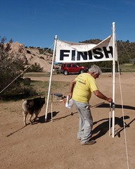 028 Kemo Takes His Bow Wow (saschmitz_earthlink_net) Tags: california dog rocks banner finish orienteering rockformation aguadulce vasquezrocks losangelescounty 2015 laoc losangelesorienteeringclub garydolgin