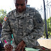 Sgt. 1st Class Carl Turner MEDRETE 15-1 takes place in Burundi, noncommissioned officer in charge of the mission command element for Medical Readiness and Training Exercise 15-1 completes a lunch roster during the exercise.Turner is a member of the 2500th