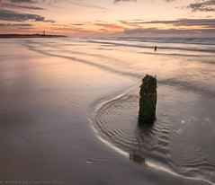 Sunset Beach (Andrew Paul Watson) Tags: sunset lighthouse seascape west reflection beach pool rock clouds sunrise long exposure angle tripod wide third fujifilm moray firth lossiemouth xt1 covesea