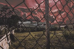 Slide or die (hitmanfre1) Tags: photography creepy moodygram moody fence swamp slide clouds red abandoned 1116mm tokina angle wide wideangle nikond3200 d3200 nikon