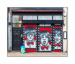 Graffiti (Zabou), East London, England. (Joseph O'Malley64) Tags: door uk greatbritain windows england streetart london shop awning graffiti mural paint britain pavement entrance spray doorway shutters curtains british cans exit aerosol intercom shopfront eastend eastlondon burglaralarm muralist zabou rollershutters refusesacks rubbishsacks