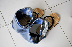 Ready to go (Roving I) Tags: waiting vietnam thongs footwear flipflops ready insideout danang jandals tilefloors jeansshorts