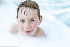 Kid In Bubbles 2 (Michael Muntz Photography) Tags: boy portrait white cute look kid intense bath blueeyes bubbles clean greeneyes nephew foam hottub stare