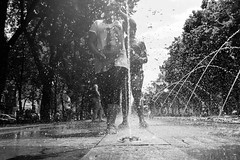 Summer in the City (marcin baran) Tags: summer sun sunny sunshine kids children water drops wet hot waterworks fountain city street streetphotography streetphoto candid candidphotography people urban gliwice poland polska marcinbaran fuji fujifilm fujix100 x100 x100t black blackwhite blackandwhite white bw monochrome pov perspective