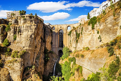 Panoramic view of the old city of Ronda, one of the famous white villages in the province of Malaga, Andalusia, Spain (Tech Pen) Tags: new old city travel bridge blue sky panorama cliff white house mountain building tourism monument nature rock stone architecture canon landscape puente town spain ancient europe mediterranean european arch village natural famous hill landmark 18th scene tourist panoramic canyon andalucia historic spanish ronda bow andalusia viewpoint malaga province nuevo
