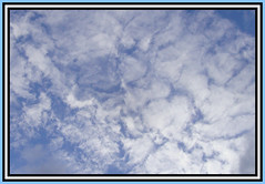 Looking Down (Margaret Edge the bee girl) Tags: blue light summer sky white face clouds outdoors