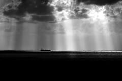 International Trade (Danny Shrode) Tags: blackandwhite monochrome clouds ocean ship sunrays