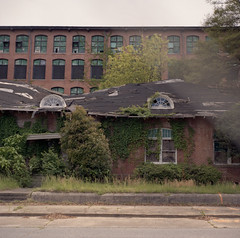 Collapsing Building I (Through Fence) (Argenticien) Tags: film decay northcarolina collapse portra bronicas2 gastonianc nikkor7528 firestonemill loraymill