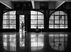 Buddha temple (shayan444) Tags: door windows people blackandwhite india reflection lines temple energy prayer bangalore divine silence frame meditation buddhatemple