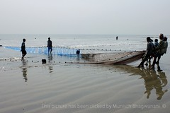 FISHING (Munisch) Tags: morning travel light sea india color net beach canon geotagged photography eos rebel photo fishing sand focus asia fishermen working human 1855mm seashore digha stillphotography 550d t2i