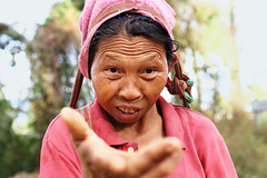 0174 Gimme money! (Mishel Breen) Tags: poverty old portrait people woman tourism senior face female asian thailand person one photo clothing hand shot adult traditional side profile poor tourist dirty beggar help mature elderly thai torn aged pai begging beg attraction shabby