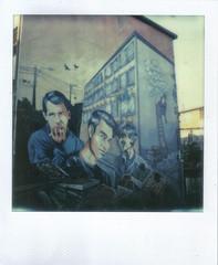 Graffiti - Los Prisioneros (hikaru86) Tags: chile santiago slr vintage project polaroid sx70 graffiti stencil mural arte jordan cielo instant abierto 690 70 86 680 sepulveda impossible hikaru sx cámara callejero instantanea hikaru86 jordansepulvedalazo