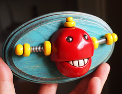 3D Robot Wall Art - Chewing Bot - Red Shabby Chic Robot Artwork (HerArtSheLoves) Tags: wood red brown smiling yellow bronze plaque happy robot wire mixedmedia happiness polymerclay oval shabbychic 3dwallart robotteeth